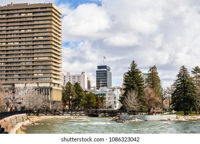 Reno, Nevada skyline as seen from the shoreline of Truckee river flowing through downtown;