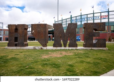 Reno, Nevada / USA - April 6, 2020: HOME is a metal sculpture by Laura Kimpton and Jeff Schomberg displayed on the lawn in front of Greater Nevada Field, Home of the Reno Aces and FC-1868 Futbol club.