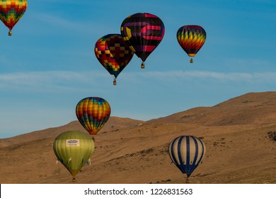 RENO, NEVADA / USA - September 6, 2018:  The Great Reno Balloon Races in the air over San Rafael Regional Park.  Mass ascension of colorful balloon in the morning.
