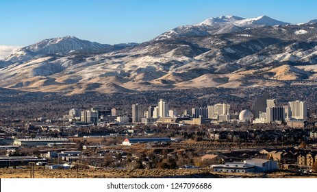 Reno, Nevada/USA-12/02/2018, Cityscape of downtown Reno, Nevada with Hotels, Casinos, housing and snow covered mountains in the background during early winter, late autumn.