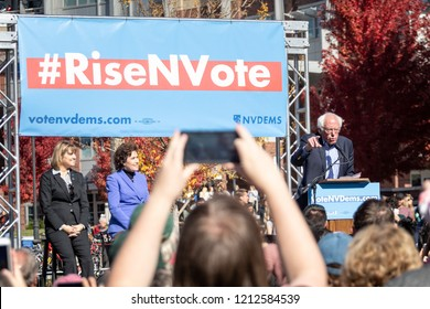 RENO, NV - October 25, 2018 - Person filming Bernie Sanders with Jacky Rosen and Kate Marshall at a political rally on the UNR campus.