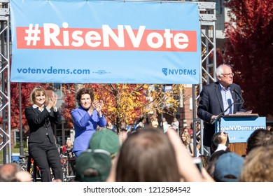 RENO, NV - October 25, 2018 - Bernie Sanders with Jacky Rosen and Kate Marshall clapping at a political rally on the UNR campus.