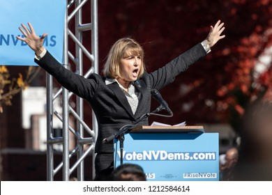 RENO, NV - October 25, 2018 - Kate Marshall with arms open yelling at a political rally on the UNR campus.
