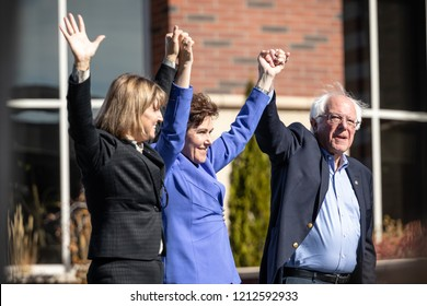 RENO, NV - October 25, 2018 - Bernie Sanders, Jacky Rosen and Kate Marshall holding hands at a political rally on the UNR campus.