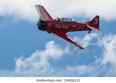 """RENO, NEVADA-Â?Â? SEPTEMBER 16:  Joey """"Gordo"""" Sanders flying his SNJ-4, called Big Red,  during the T-6 Gold Medal race at the National Championship Air Races on September 16, 2012 near Reno, Nevada."""