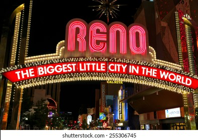"""RENO, USA - AUGUST 12: """"The Biggest Little City in the World"""" sign  over Virginia street at night on August 12, 2014 in Reno, USA.  Reno is the most populous Nevada city outside of the Las Vegas."""