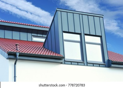 Renovated Metal plated Dormer Windows on a tiled Roof