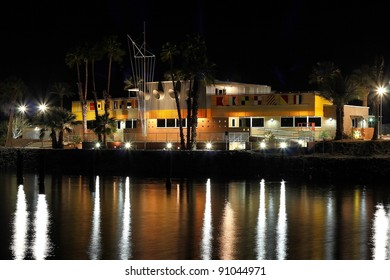 Renovated North Shore Beach & Yacht Club at the Salton Sea at nighttime. Reflections on the water. Desert modern architecture by architect Albert Frey.
