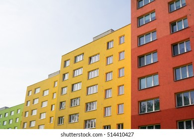 Renovated and renewed complex of blocks of flats - building has colorful facade. Cheap social housing for poor people. Low angle shot with copy space area (dynamic composition)