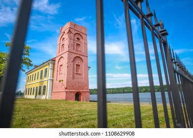 Renovated tower that is part of the City museum on the coast of river Danube viewed thru the fence in Vukovar, Croatia.