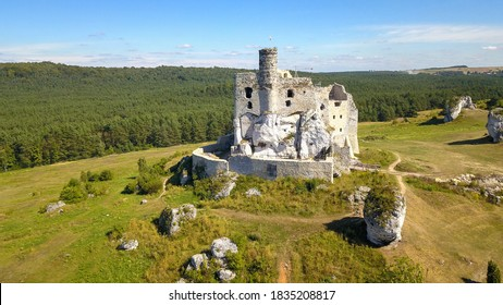 Renovation the castle in Mirow (Poland) - A monumental castle building lies on a hill. Aerial view.