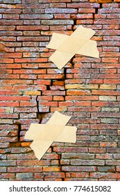 Renovation of cracked brick wall - concept image with adhesive tape