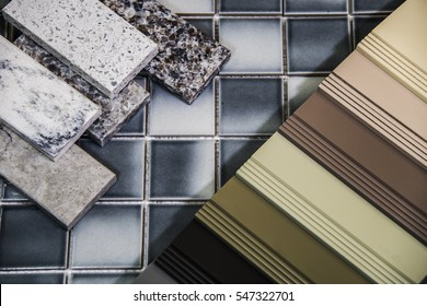 Renovation martial selection of granite and marble countertops, cabinet colors and tile flooring for new modern interior kitchen project