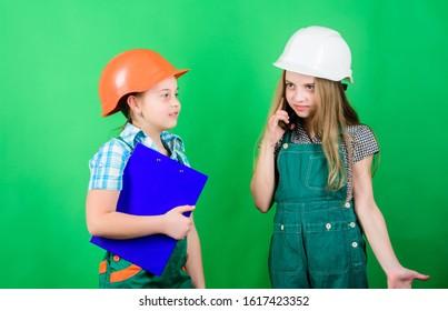 Renovation plan. Home improvement activities. Builder engineer architect. Future profession. Kids girls planning renovation. Initiative children girls provide renovation their room green background.