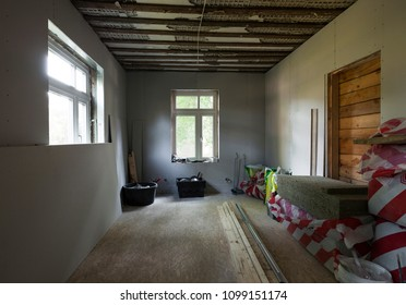 Renovation process: apartment in timber house being isolated with mineral wool and drywall.