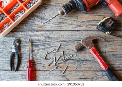 renovation tool on wood background