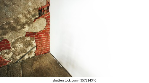 Renovation wall, old red brick, cement floor. White plaster wall background for text