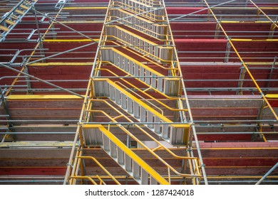 Renovation works. Safety in workplace. Scaffolding protects the workers from accidents. Under view.