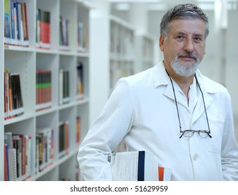 Renowned scientist/doctor in a library of research center/hospital looking confident