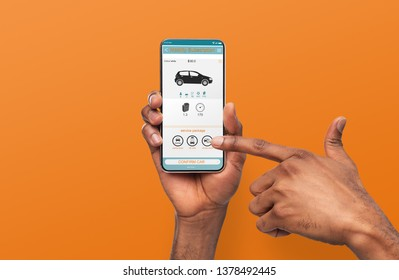 Rent car online for short trips around city. Sharing Economy. Black guy using mobile application, orange background