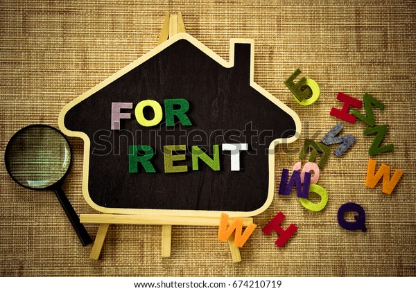 FOR RENT  words on wooden  background