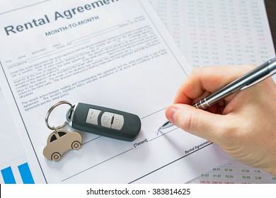 Rental agreement for a car with contract, pen and keys