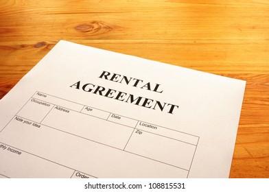 rental agreement form on desktop in business office showing real estate concept