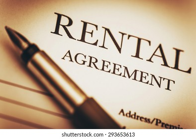 Rental Agreement and Fountain Pen. Ready to Sign Rental Contract. Residential Real Estate Concept Photo.