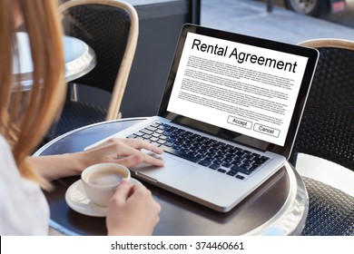rental agreement, rent a car or house, woman reading tenancy contract on the screen of laptop