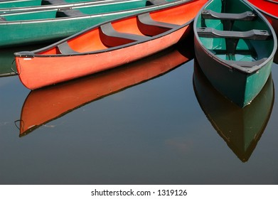 Rental canoes tied up at wharf at the pavilion on Dows Lake in central Ottawa, Ontario, Canada