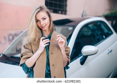 Rental car customer fyoung woman blonde hair driver