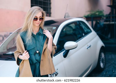 Rental car customer fyoung woman blonde hair driver lifestyle