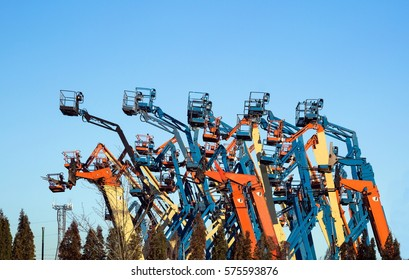 Rental construction  equipment. Boom lifts  with raised platforms are on-site on   for the equipment for rent.