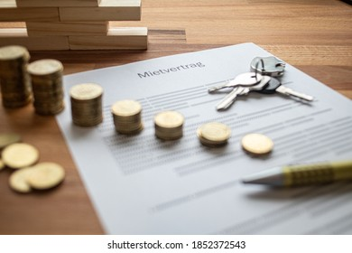 a rental contract on a table with some coins and a key chain on a table