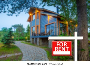 Rental properties outside city. Red for rent sign as a symbol of rental properties. Delivery of country rental properties. Modern rustic cottage in background. It is rented for tourists.