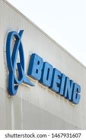 """Renton, Washington / USA - July 31 2019:  """"Boeing"""" sign on the exterior of the 737 MAX airliner factory in Renton, home to the 737 MAX 8, MAX 9, and MAX 10 production lines"""