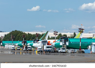 Renton, Washington / USA - July 31 2019: Row of Boeing 737 MAX airliners parked outside the Renton factory, with space for text on top
