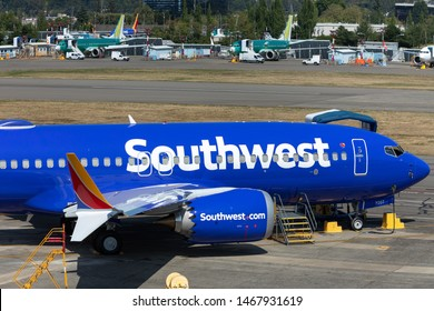 Renton, Washington / USA - July 31 2019: Grounded Southwest Boeing 737 MAX airplane, parked at the Renton airliner factory, with furloughed jets in the background