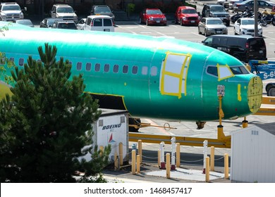 Renton, Washington / USA - July 31 2019: Close up on the green fuselage for a Boeing 737 MAX airliner on a train car outside the Renton factory, home to the 737 MAX 8 assembly line