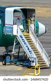 Renton, Washington / USA - July 31 2019: New airplane with Boeing 737 access stairs, at the 737 MAX airliner factory in Renton