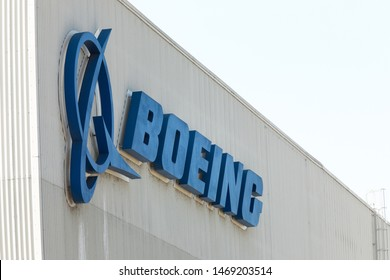 """Renton, Washington / USA - July 31 2019:  """"Boeing"""" sign on the exterior of the 737 MAX airliner factory in Renton, home to the 737 MAX 8, MAX 9, and MAX 10 production lines, with space for text"""