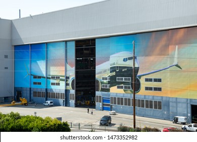 Renton, Washington / USA - July 31 2019: Hangar door for the Boeing 737 MAX airplane factory, home to the 737 MAX 8, MAX 9, and MAX 10 assembly lines, in an industrial aviation scene