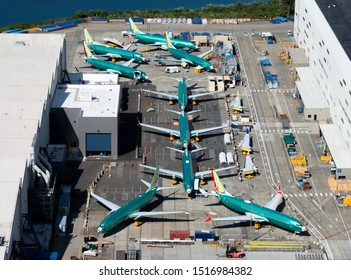 Renton, Washington / USA - September 09 2018: Multiple Boeing 737 MAX and NG parked outside the company factory at  Renton Airport.