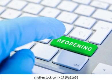 Reopening concept after the coronavirus pandemic. Hand ready to push Keyboard with green key and text