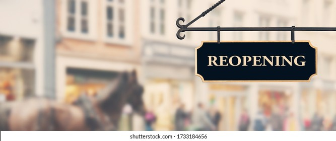 Reopening economy concept. Sign with word reopening hanging against open shop windows background. Restarting business after coronavirus lockdown. Economy recovery symbol - Shutterstock ID 1733184656