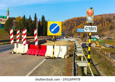repair of an automobile bridge across the Bolshoi Inzer river on the Beloretsk Ufa highway on a sunny autumn day. Russian text: stop.