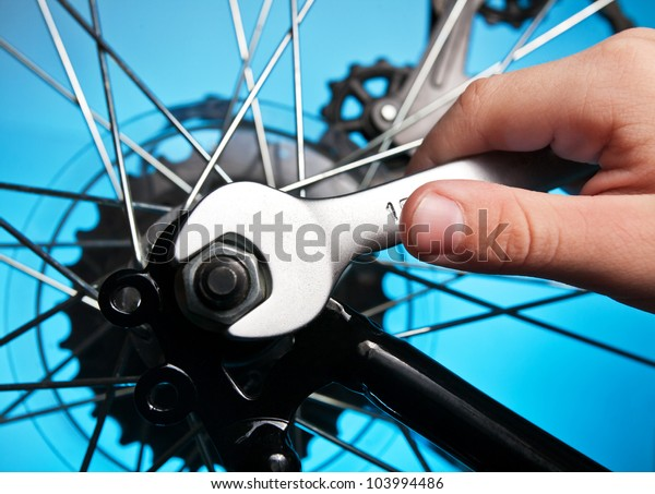 repair of a bicycle with a wrench