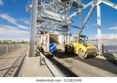 Repair of the bridge in Arkhangelsk. Road machinery on the bridge. Russia, Arkhangelsk