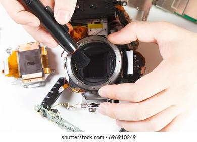 Repair broken digital SLR camera service center closeup.