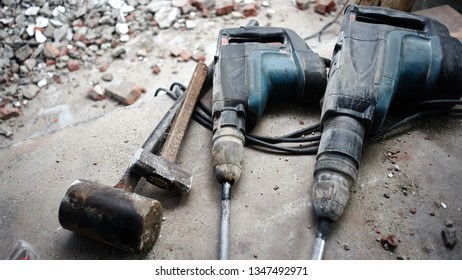 Repair and building a house. Construction tools, jackhammer on the floor of the destroyed building